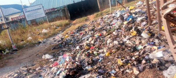 Entrance to Bema homes for the less privileged in Piwoyi filled with refuse.