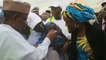 Sokoto State Governor, Aminu Tambuwal immunising a child