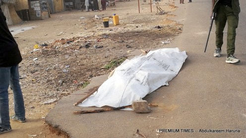 Corpse covered with polythene after the Boko Haram attack