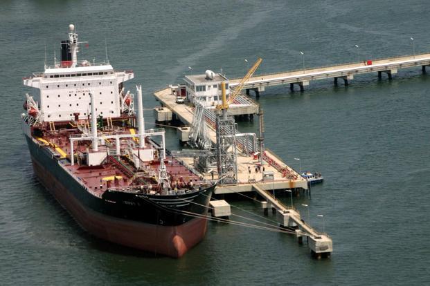 Oil prices slip as U.S. crude output nears 12 million bpd