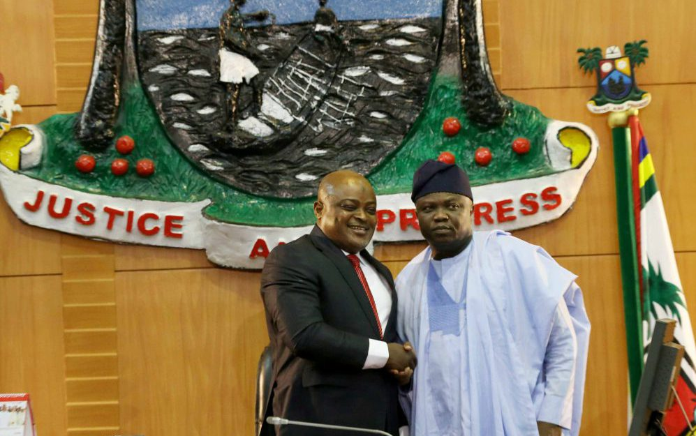 Lagos State Governor, Mr. Akinwunmi Ambode (right), in a handshake with the Speaker, Lagos House of Assembly, Rt. Hon. Mudashiru Obasa during the presentation of the Y2018 Budget Estimates to the House, at the Assembly Complex, Alausa, Ikeja, on Monday, December 11, 2017.