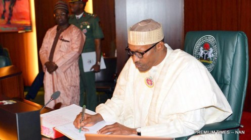 President Mummadu Buhari signing a Condolence Register for the late Former Vice President, Dr Alex Ekwueme at the Presidential Villa Abuja on Thursday (21/12/17/) 06969/21/12/2017/Ibrahim Ejiga/ICE/NAN