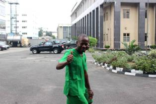 2nd Accused Person, Ogochukwu Nnamiro hailing a friend at the High Court after his arraignment on Friday.