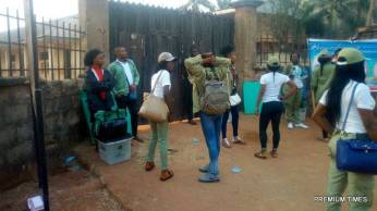Ad-hoc staff waiting to gain entrance into Nkwelle primary school, Awka, Awka South. Ward 006, 007, and 008.