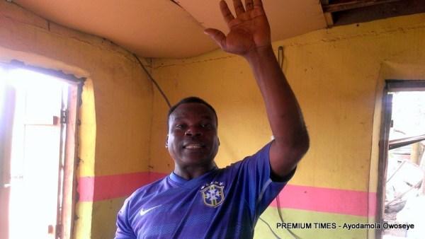 Amos Dunamis raising his broken arm after healed.