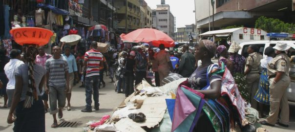 Nigerians on the street going about their daily business. [Photo credit: Quartz]