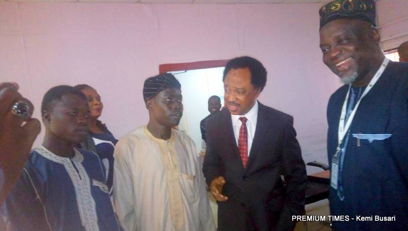 Image result for Shehu sani goes to jamb office with snake charmers