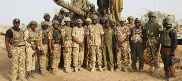 FILE: The Chief of Army Staff, Tukur Buratai and the Nigerian Military troops in Camp Zairo.