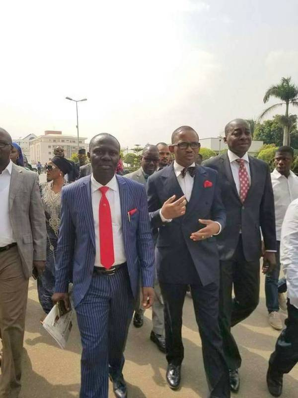 Ibrahim Babangida's spokesperson, Kassim Afegbua and his lawyer, Kayode Ajulo, in arriving force headquarters