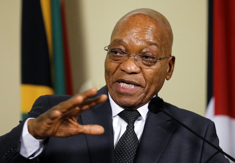 Former South Africa President Jacob Zuma gestures during a media briefing with Palestinian President Mahmoud Abbas (not pictured) at the Union Building in Pretoria November 26, 2014. REUTERS/Siphiwe Sibeko (SOUTH AFRICA - Tags: POLITICS)