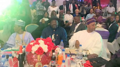 Bayelsa State governor, Seriake Dickson (middle) flanked by former minister of Water Resources, Mukhtar Shagari (left) and chairperson of the occasion at the DAAR Award night on Thursday in Abuja