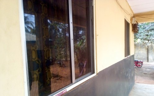 One of the hostels painted and window netted by Corps member Jennifer Ejiogu