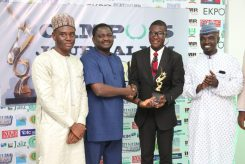 Presidential Spokesperson, Mr Femi Adesina presents award to Alfred Olufemi from OAU at the Campus Journalism Awards in Abuja while organisers, Gidado Shuaib and Yushau Shuaib look on