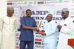 Presidential Spokesperson, Mr Femi Adesina presents award to Publisher of PREMIUM TIMES online media, Dapo Olorunyomi.