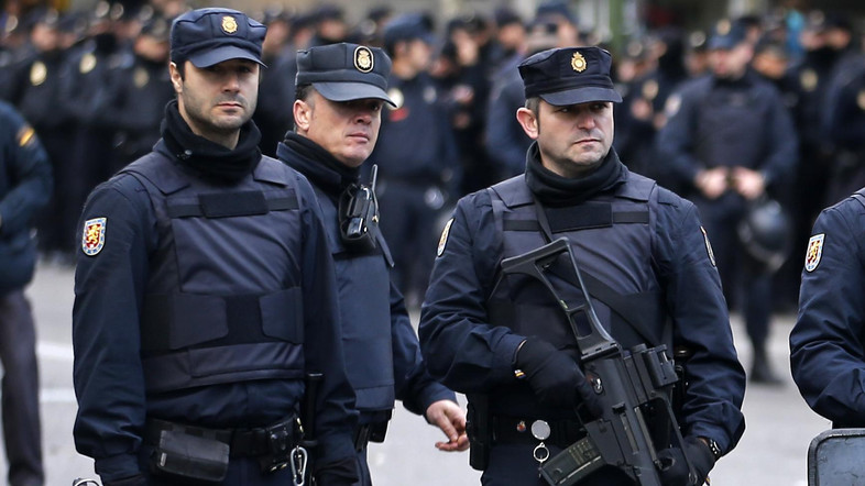 FILE PHOTO: Police stand outside Real Madrid's Santiago Bernabeu stadium in Madrid, Spain, Saturday, Nov. 21, 2015. Unprecedented security measures are in place for the first clasico of the season between Real Madrid and Barcelona, with nearly 3,000 policemen and private security officers dispatched to guarantee public safety at the Santiago Bernabeu stadium in Madrid. (AP Photo/Paul White)
