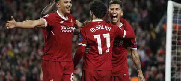 Firmino celebrates scoring the fourth with Mohamed Salah and Trent Alexander-Arnold. Photograph: Tom Jenkins for the Guardian