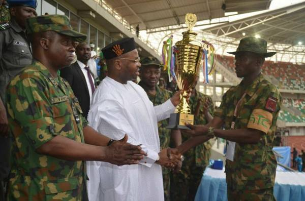 Gov Udom Emmanuel presenting trophy to the winning team at the just concluded Nigerian Air Force combat sports competition in Uyo