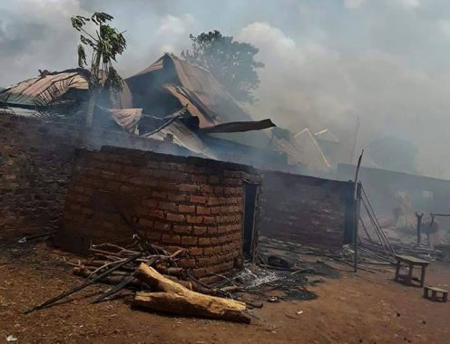 A mud building set ablaze by soldiers in Benue community