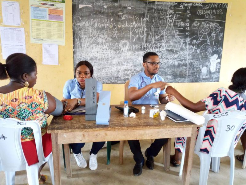 Doctors from Society for Family Physicians of Nigeria administering free medical tests to teachers in a local school in Uyo, Akwa Ibom State