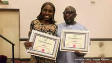 Premium Times' Publisher, Dapo Olorunyomi and Judiciary reporter, Evelyn Okakwu after receiving the Torchbearer of Press Freedom Award.
