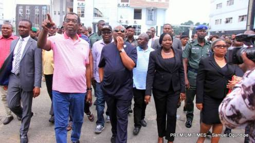 Rivers State Governor, Nyesom Ezenwo Wike (m), Chief Judge of Rivers State, Justice Adama Iyayi-Laminkara (2nd R), Attorney General of Rivers State, Emmanuel Aguma (SAN) (2nd L) during his inspection of State High Court Complex destroyed by APC and Police on Friday.