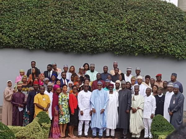 "Nigerian youths in a group photograph with President Muhammadu Buhari after signing the ""not too young to run"" bill into law"