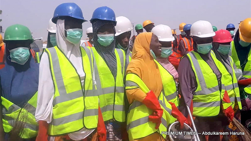 IDPs equipped with safety gears to clean up their communities