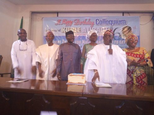 Mr Ajibade (3rd left); wife (third right), Governor Aregbesola (2nd left), Kingsley Moghalu (left), Osoba (2nd right) Bisi Fayemi (right)