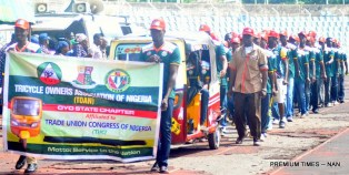 Members of Tricycle Union during a match past at the 2018 May Day celebration in Ibadan on Tuesday (1/5/18) 00261/1/5/18/Timothy Adeogodiran/NAN