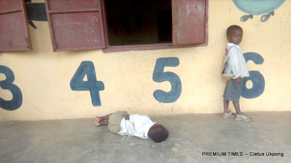 Pupil sleeps on the verandah of a classroom in Ukana Iba, Essien Udim