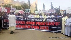 Catholic faithful during a peaceful prayerful procession to protest the killing of Catholic Priests and other Christians in Benue State, in Abuja on Tuesday