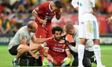 Liverpool Physio Team attending to Mo Salah after he was wrestled down by Sergio Ramos [Photo: Real Madrid Twitter page]