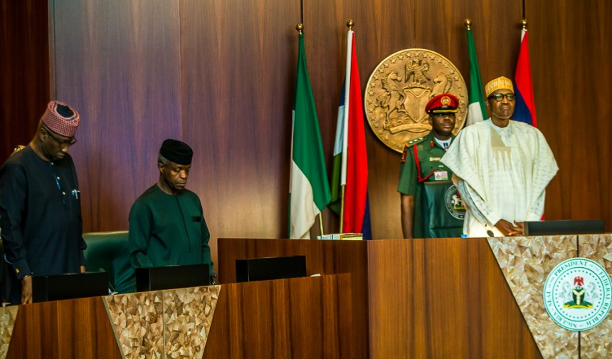 President Buhari presiding over a FEC meeting by Novo Isioro