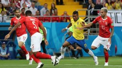 Brazil's Paulinho in action as Switzerland gets behind the ball