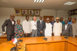 Hon. Minister of Power, Works & Housing, Mr Babatunde Fashola, SAN(3rd right), Permanent Secretary Works & Housing, Mr Mohammed Bukar(middle), Director Human Resource, Mrs Morayo Alimi(2nd left),former Assistant Technical Adviser of the Super Eagles, Bonfrere Jo (4th left), Legal Consultant to Mr Jo, Mr Obasanjo Lawal Esq. (left) , former Super Eagles player, Benedict Akwuegbu (3rd left), Director Public Buildings and Housing Development, Mr Dickson Onoja (3rd right) and others in a group photograph shortly after the handing over of the keys of the Federal Government allocated House to the Coach in fulfillment of Government's Pledge 24 years ago for Winning the 1994 African Cup of Nations at the Ministry of Power,Works & Housing Headquarters, Mabushi, Abuja on Tuesday 5th, June 2018.