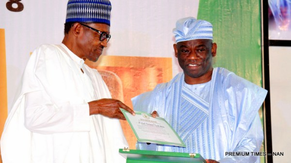 President Muhammadu Buhari presenting a Post-Humus GCFR Award to Mr Kola Abiola, son of the acclaimed winner of June 12 1993 Presidential Election, Chief MKO Abiola during a Special National Honours Investiture at the Presidential Villa in Abuja on Tuesday (12/6/18) 03138/12/6/2018/Callistus Ewelike/BJO/NAN