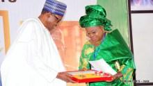 President Muhammadu Buhari presenting a Post-Humus GCON Award to Mrs Bukola Fawehinmi, wife of late civil rights activist, Chief Gani Fawehinmi, during a Special National Honours Investiture at the Presidential Villa in Abuja on Tuesday (12/6/18) 03139/12/6/2018/Callistus Ewelike/BJO/NAN