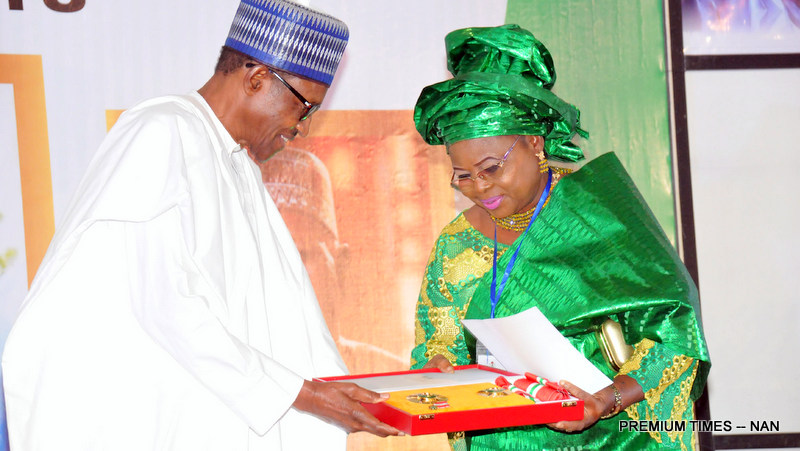 President Muhammadu Buhari presenting a Post-Humus GCON Award to Mrs Bukola Fawehinmi, wife of late civil rights activist, Chief Gani Fawehinmi, during a Special National Honours Investiture at the Presidential Villa in Abuja on Tuesday (12/6/18) 03139/12/6/2018/Callistus Ewelike/BJO/NAN