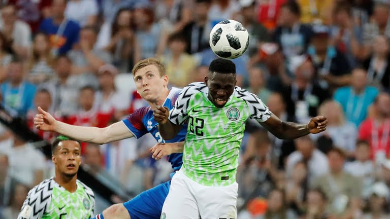 Kenneth Omerou reaching for a header during the Iceland v Nigeria match