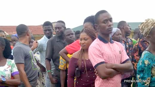 1:35 pm Long queue at St. Marks Primary School, Ise/Orun ward 2, unit 3 where 647 registered voters are billed to vote. Voting started by 8:12am we were told. Meanwhile, vote buying continues as those who vote show their PVC's, vote then go to men seated by the side, they give them a piece of paper with a number corresponding with their register, such people are then directed by another man in blue overall, power bank in hand as will be observed. He then directs such person to a building opposite the school where the settlement is done.