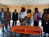 Corp member, Esther Akpan, donating desks to a school in Uruan, Akwa Ibom