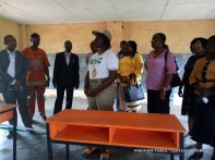 Corp member, Esther Akpan, donating desks to a school in Uruan, Akwa Ibom
