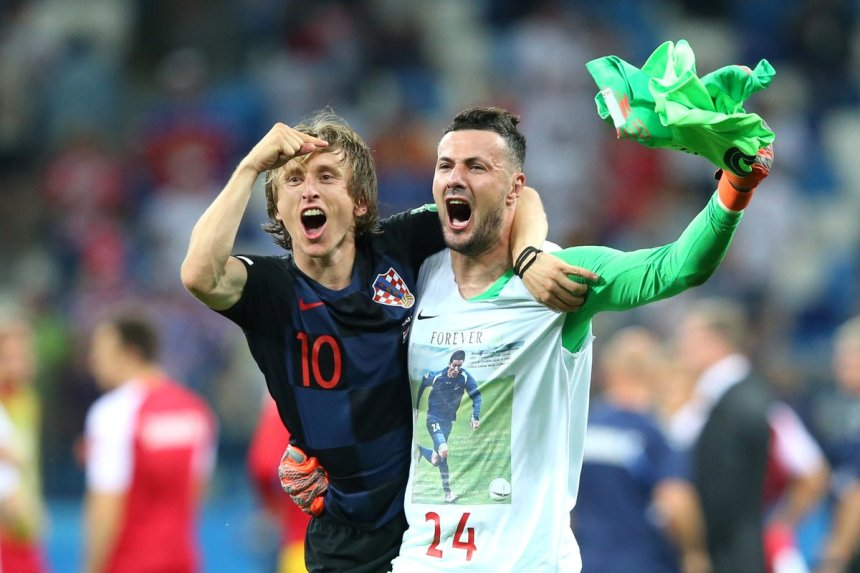 Luka Modric and Subasic celebrates after winning their match against Denmark by penalty shoot-out