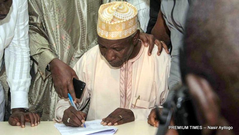 Buba Galadima Chairman of R-APC signing the MOU