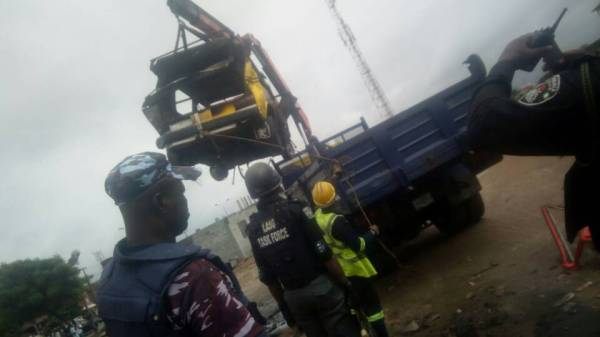 The scene of the collision of the danfo bus with the train in Agege