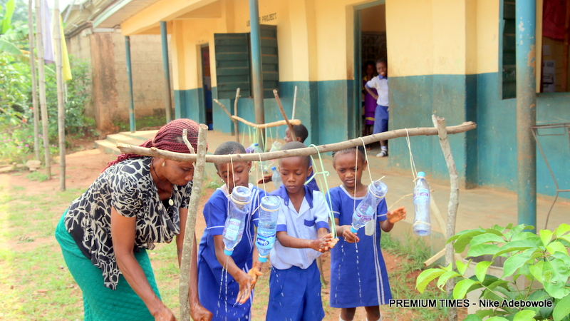 Some pupils of Anuli community school, Ezenifite in Anambra state, using the Tiptap to wash their hands.