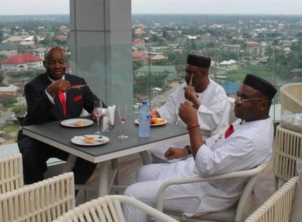 Former Gov. Godswill Akpabi and the present Gov. Emmanuel Udom Having lunch with an associate