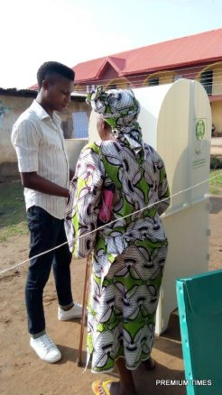 """Old woman assisted by her """"son"""" at PU 15 ward 9, Emure"""