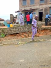 The man in the red cloth, who is a PDP party agent want to assist his mother with casting of vote at isare ward 9, unit 5 Efon Alaye 08:55am.