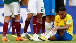 Alavarez gets a yellow card for a dangerous challenge on Neymar who clutches to his kneel. Free kick for Brazil